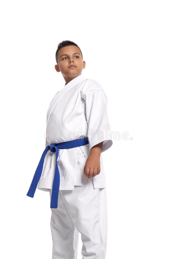 Full length portrait of karate serious boy in white uniform and blue balt, isolated. Full length portrait of karate young boy in white uniform and blue balt stock photography