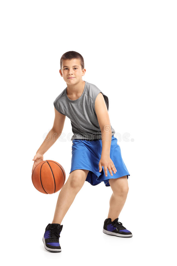 Full length portrait of a kid playing with a basketball royalty free stock photo