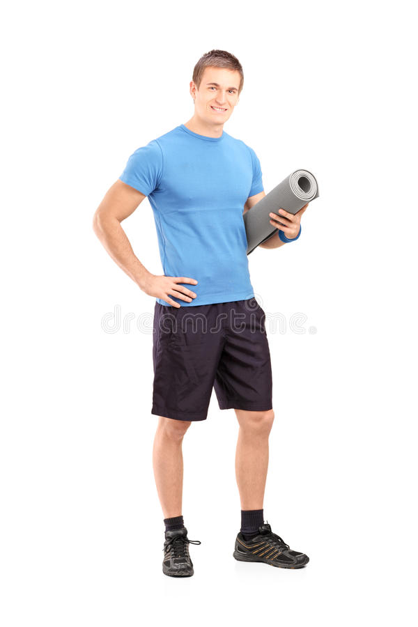 Full Length Portrait Of A Male Athlete Holding A Mat Stock Photos