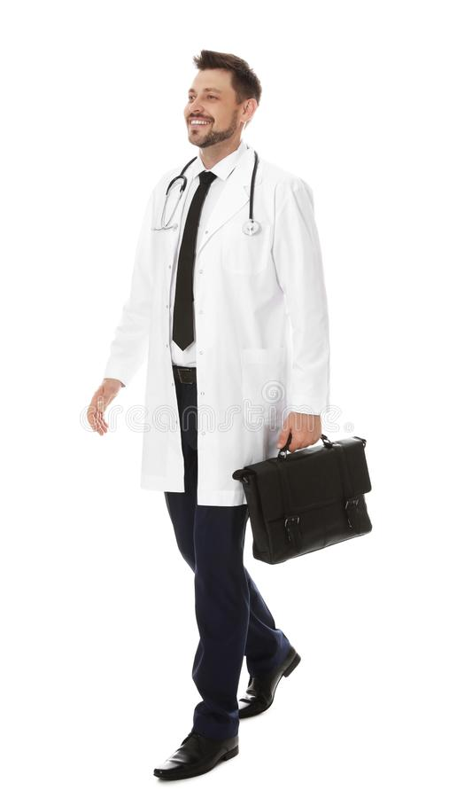Full length portrait of male doctor with briefcase isolated. Medical staff. Full length portrait of male doctor with briefcase isolated on white. Medical staff royalty free stock photos