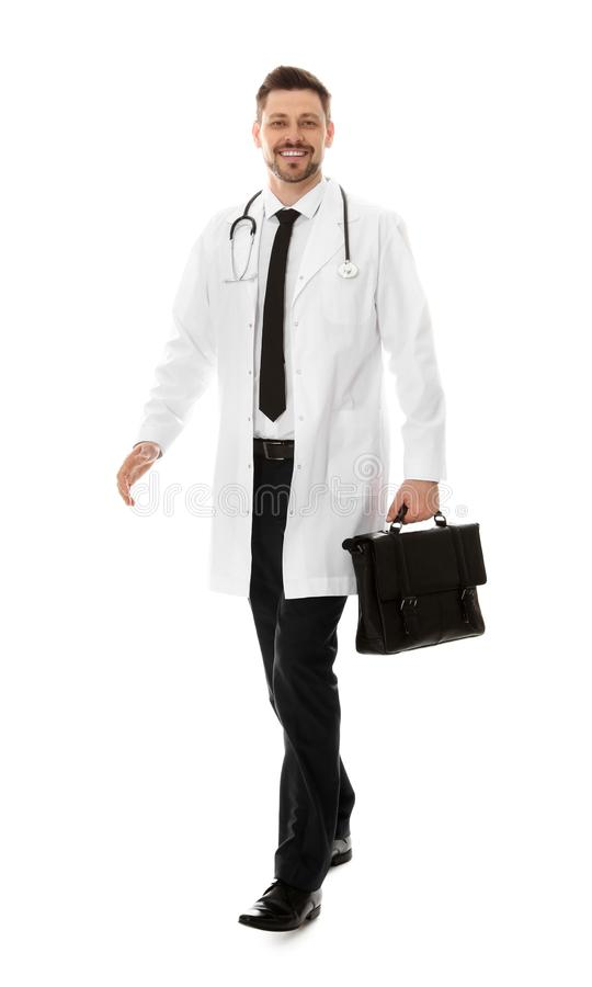 Full length portrait of male doctor with briefcase. Medical staff. Full length portrait of male doctor with briefcase isolated on white. Medical staff stock images