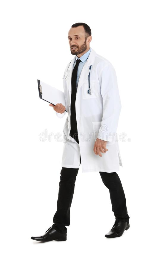 Full length portrait of male doctor with clipboard. Medical staff. Full length portrait of male doctor with clipboard isolated on white. Medical staff stock images