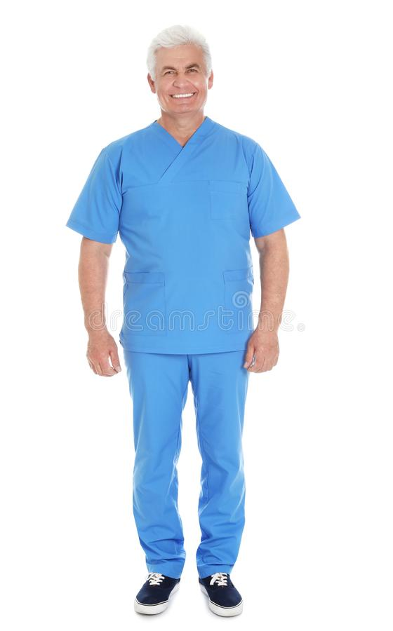 Full length portrait of male doctor in scrubs isolated on white. Medical staff royalty free stock photos