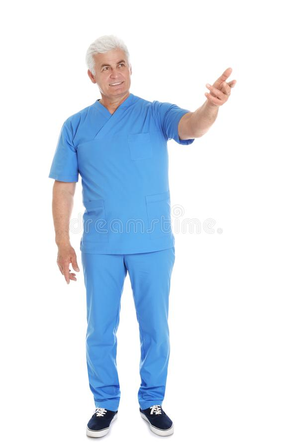 Full length portrait of male doctor in scrubs on white. Medical staff. Full length portrait of male doctor in scrubs isolated on white. Medical staff royalty free stock photos