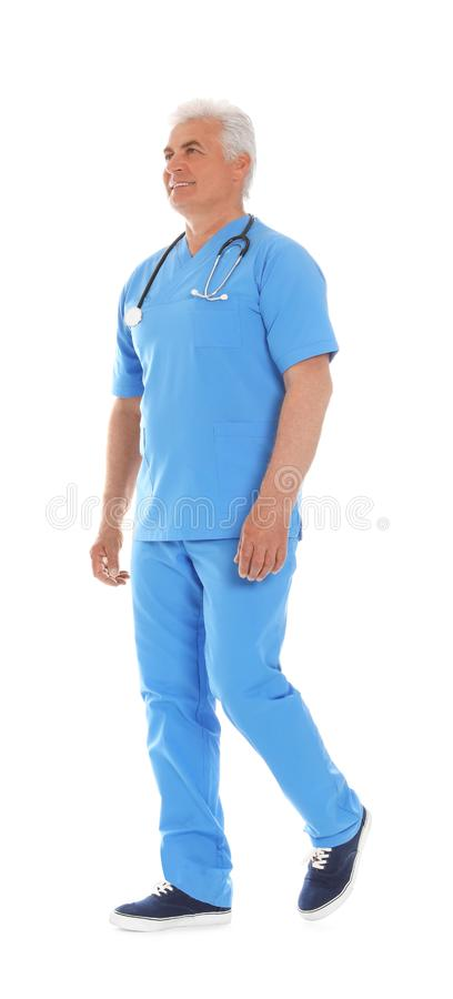 Full length portrait of male doctor in scrubs with stethoscope isolated on white. Medical staff royalty free stock photos