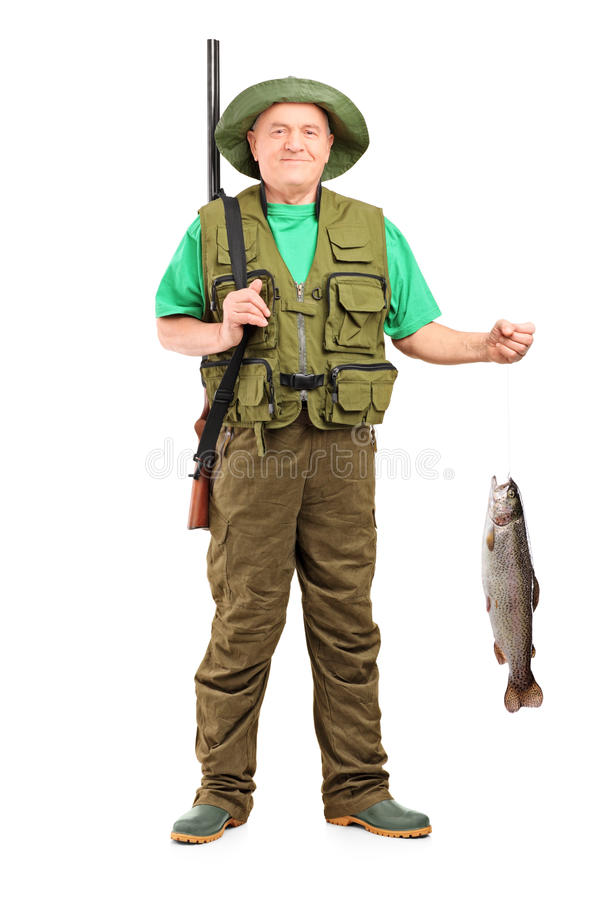 Download Full Length Portrait Of A Male Hunter With Rifle Holding A Fish Stock Photo - Image: 28463370