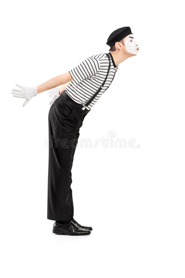 Full length portrait of a male mime artist gesture kissing