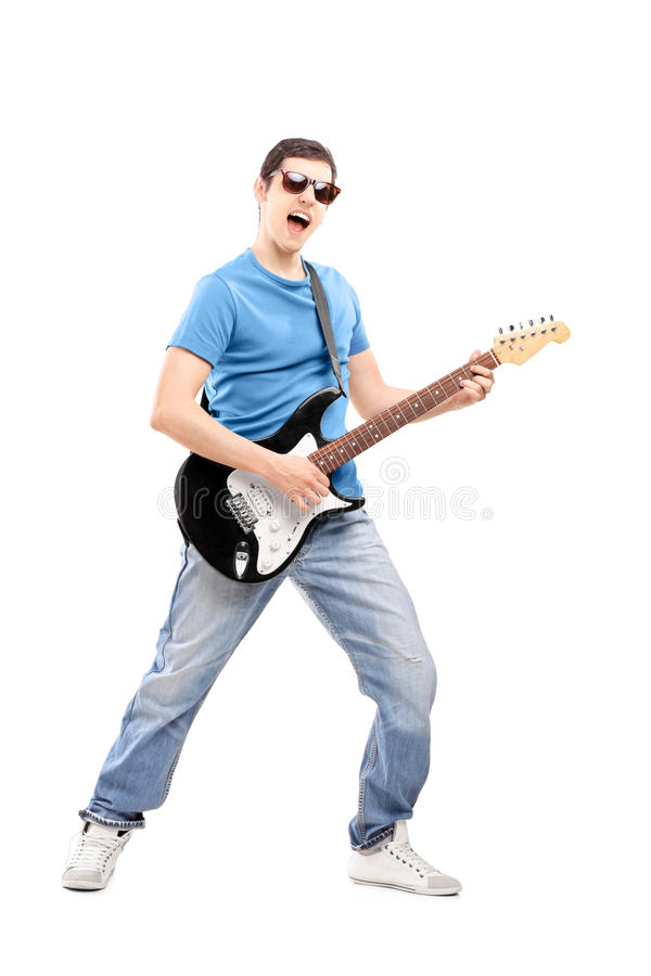 Download Full Length Portrait Of A Male Musician Playing An Electric Guit Stock Photo - Image: 31218764