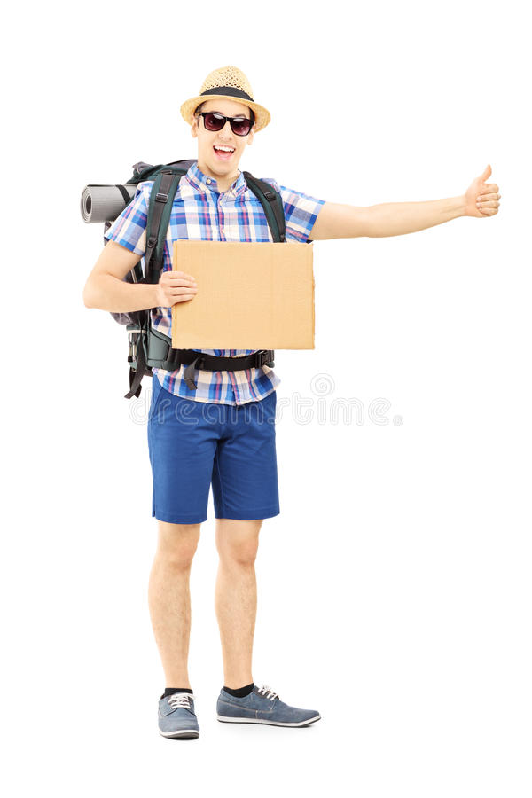 Full length portrait of a male tourist with backpack hitchhiking. Isolated on white background stock images