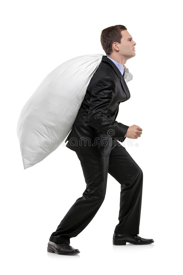 Full length portrait of a man carrying a money bag stock image