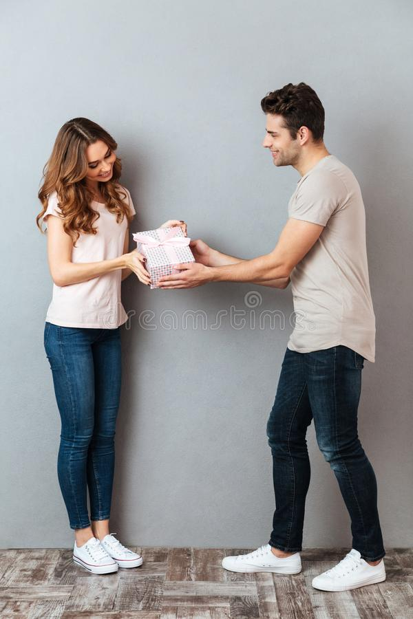 Full length portrait of a man giving a present box stock photography