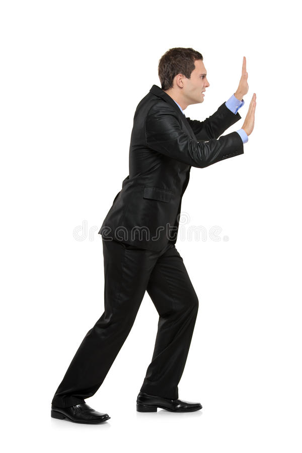 Download Full Length Portrait Of A Man Pushing Something Stock Photo - Image: 16566942