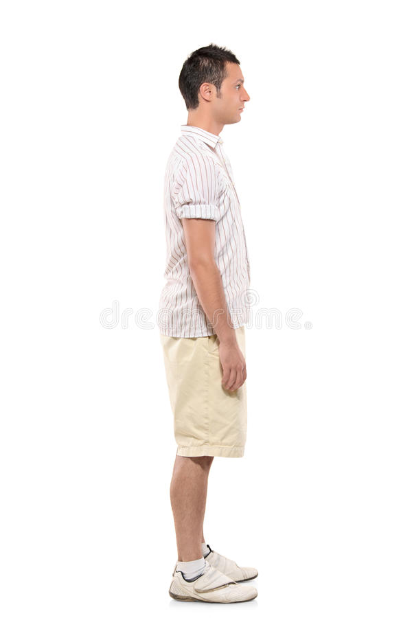 Full length portrait of a man standing in a line. Against white background royalty free stock photography