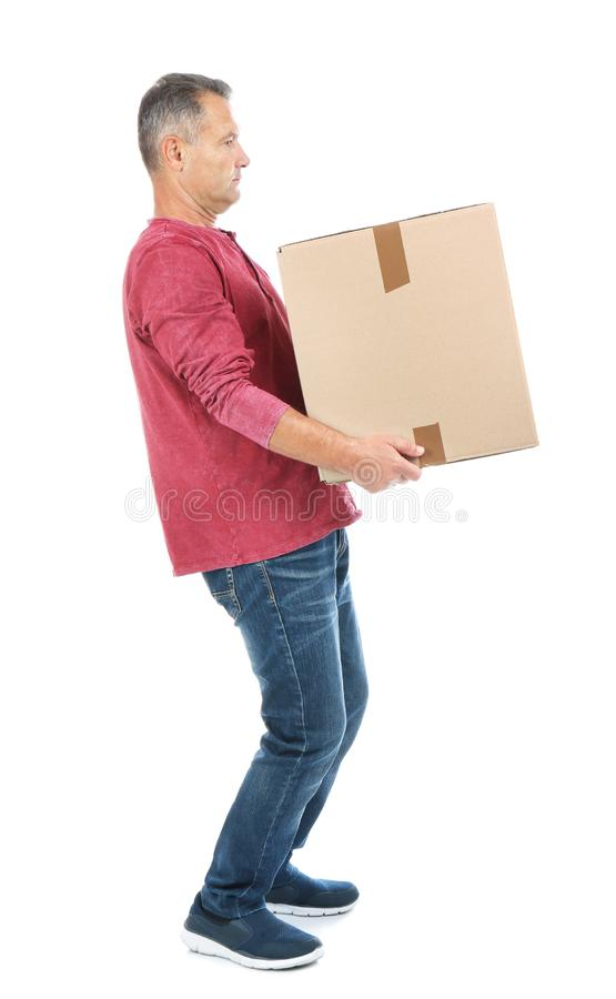 Full length portrait of mature man carrying carton box stock photos
