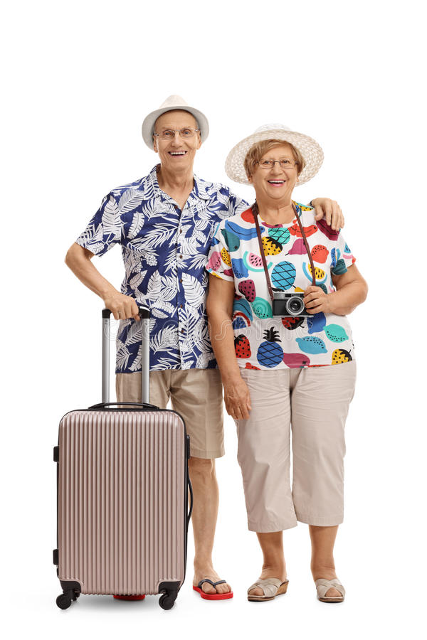 Full length portrait of mature tourists with a suitcase royalty free stock photography