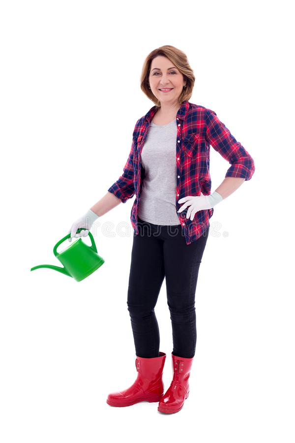 Full length portrait of mature woman gardener with watering can isolated on white background stock photography