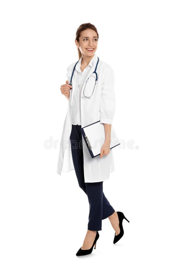 Full length portrait of medical doctor with clipboard and stethoscope royalty free stock photos