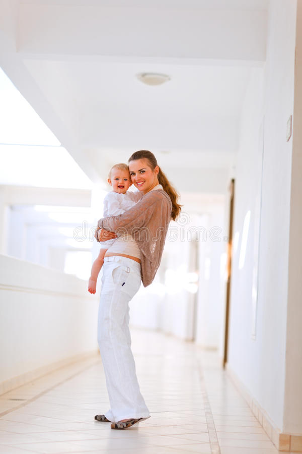 Full length portrait of mother and smiling baby stock photography