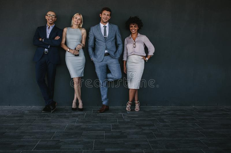 Multiracial team of business professionals standing together royalty free stock photography