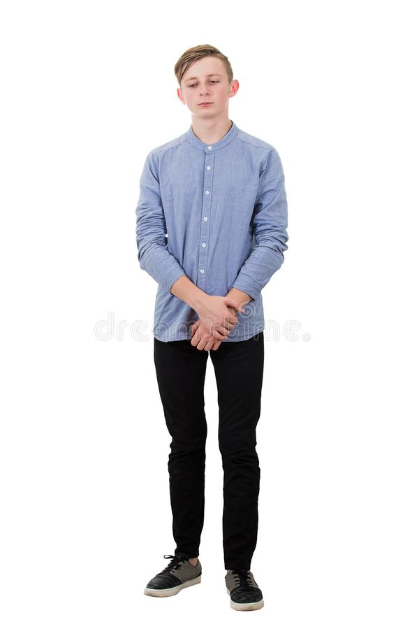 Free Full Length Portrait Of Thoughtful Teenager Guy Looking Down As Feel Guilty And Ashamed Isolated Over White. Boy Experiencing Stock Photos - 158771403