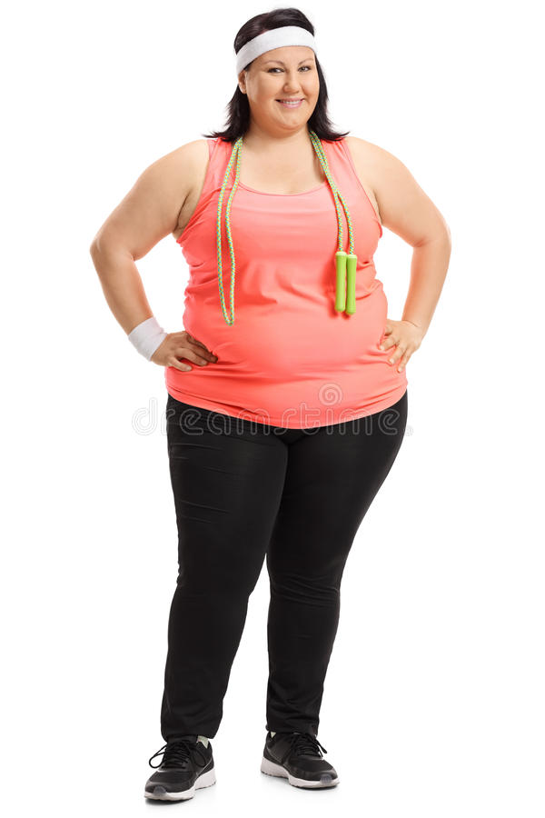 Full length portrait of an overweight woman with skipping rope royalty free stock photo