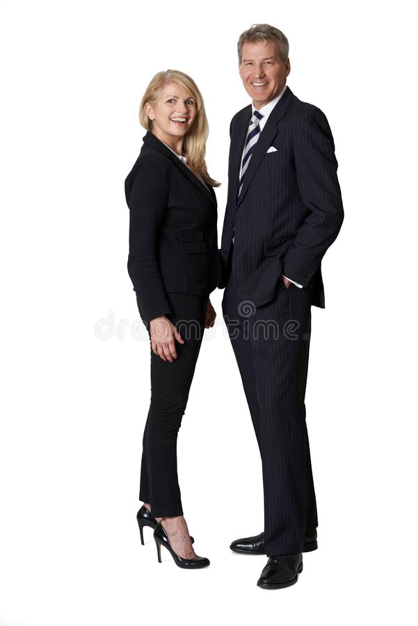Full Length Portrait Of Portrait Of Mature Businesswoman And Businessman Against White Background royalty free stock photo