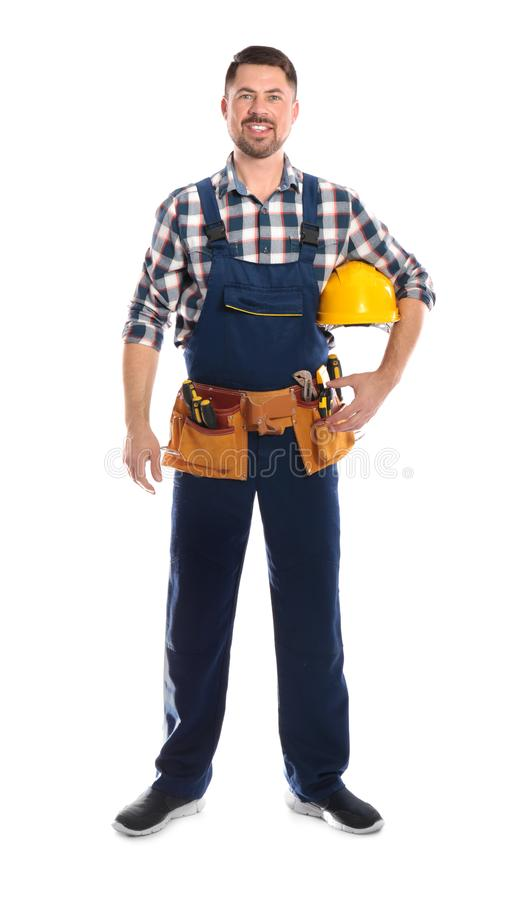Full length portrait of professional construction worker with hard hat and tool belt royalty free stock photography