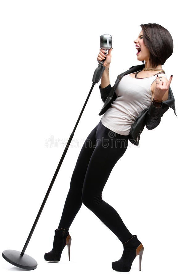 Full-length portrait of rock musician with mike royalty free stock photo