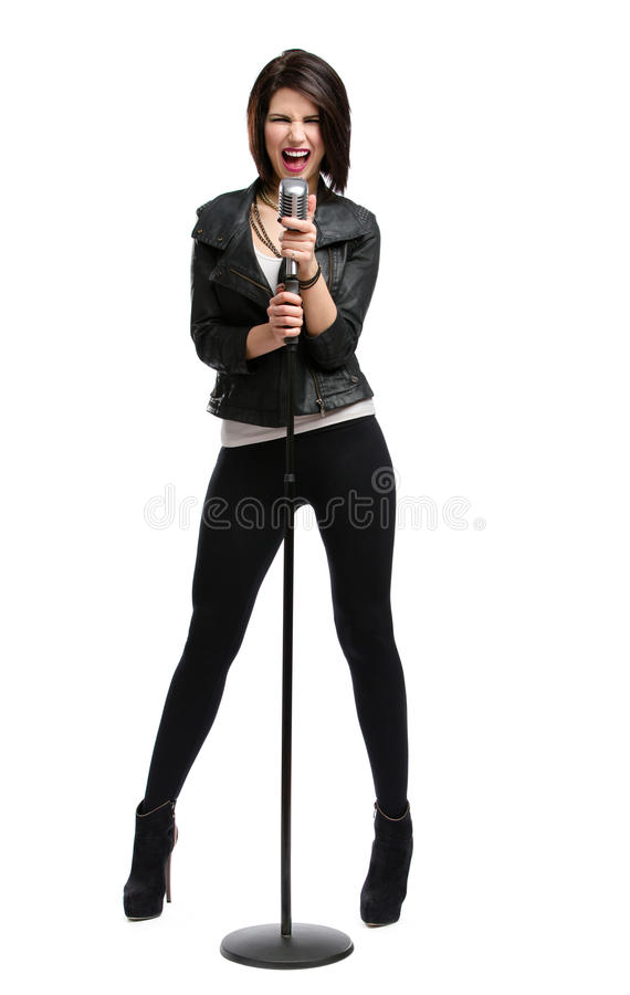 Full-length portrait of rock singer with mic stock images