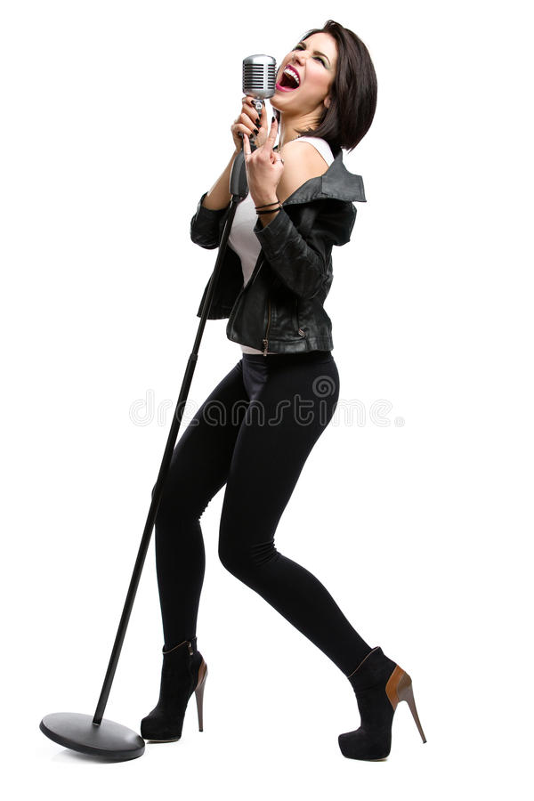 Full-length portrait of rock singer with microphone royalty free stock photos