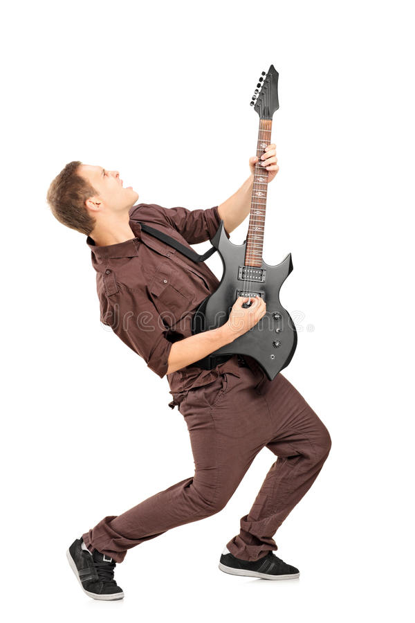 Full length portrait of a rock star playing guitar stock photography