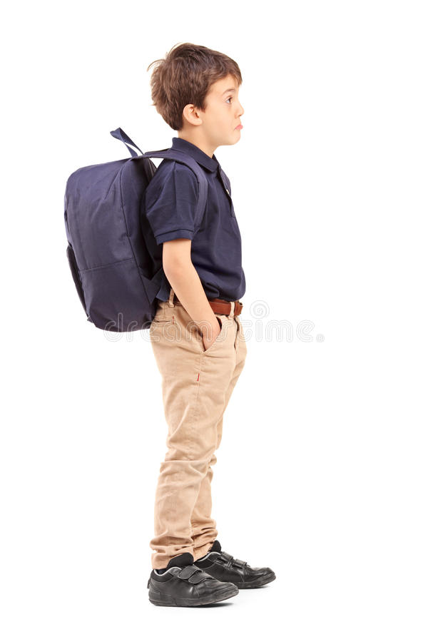 Full length portrait of a school boy with backpack standing. Isolated on white background stock photography