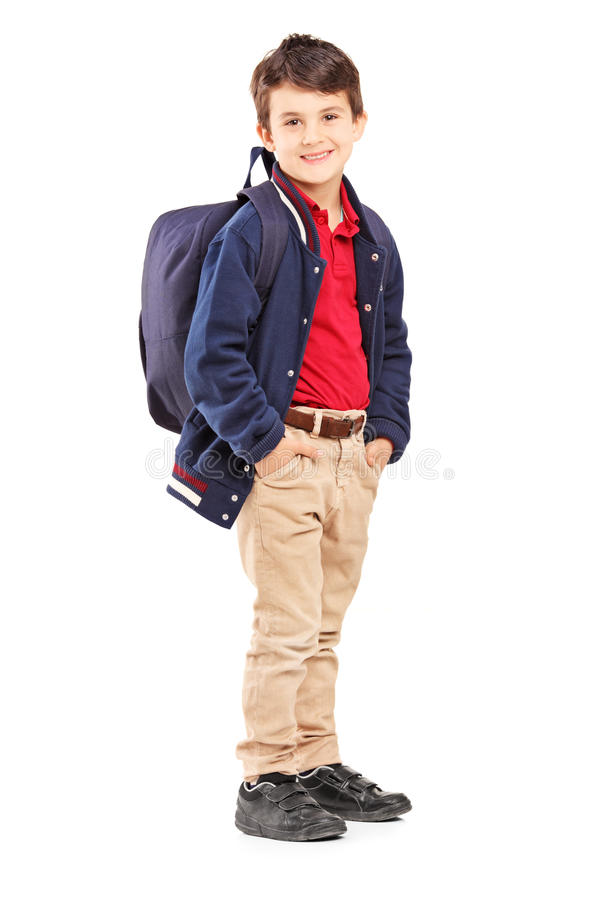 Full length portrait of a school boy with backpack standing. And looking at camera, isolated on white background stock photography