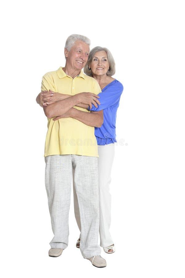 Portrait of senior couple embracing on white background royalty free stock images