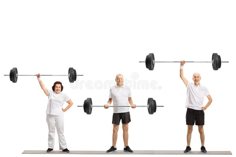Senior people exercising with barbells royalty free stock photos