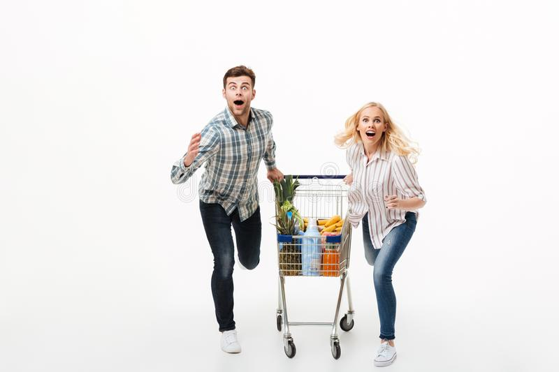 Full length portrait of a shocked couple stock photos
