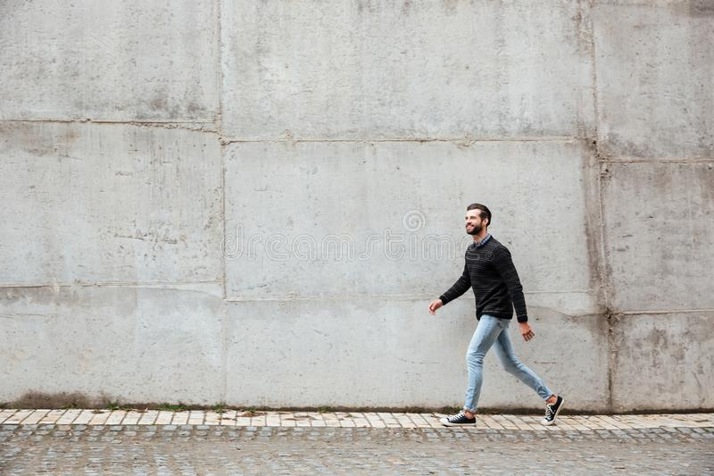 Full length portrait of a smiling casual man stock images
