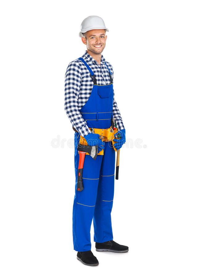 Full length portrait of smiling construction worker in uniform a stock images