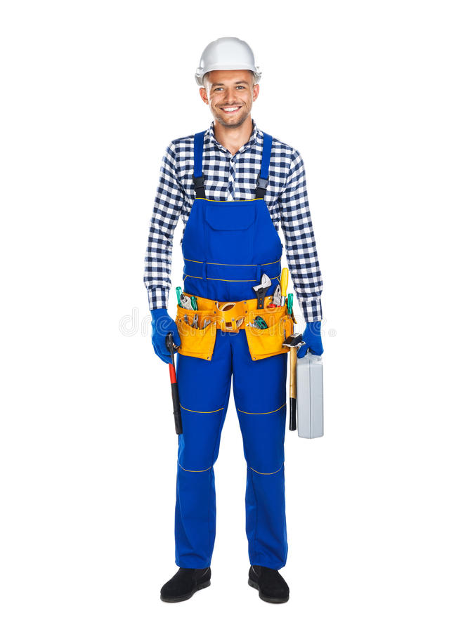 Full length portrait of smiling construction worker in uniform w stock images