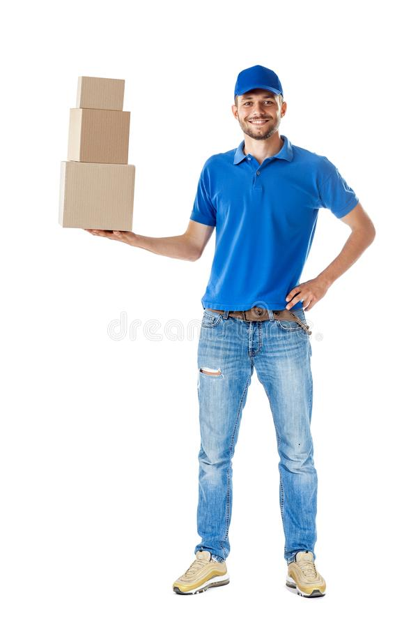 Full length portrait of smiling delivery man holding pile of car stock photography