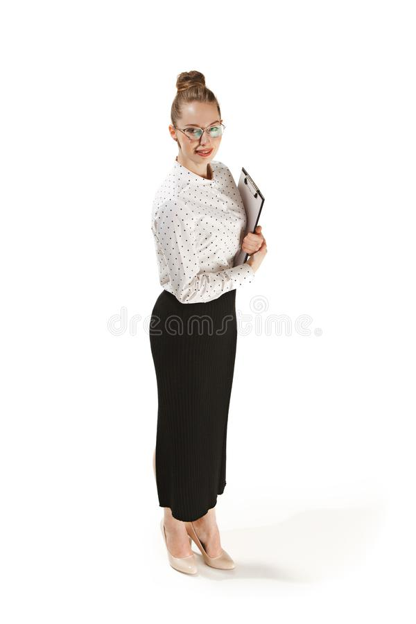 Full length portrait of a smiling female teacher holding a folder isolated against white background royalty free stock images