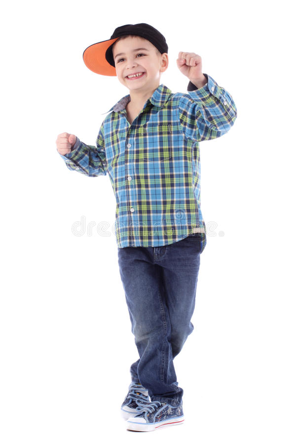 Full length portrait of smiling little boy in jeans royalty free stock photography