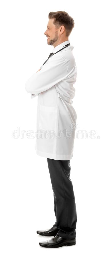 Full length portrait of smiling male doctor isolated on white royalty free stock photo