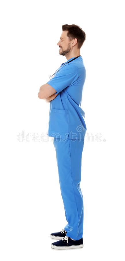 Full length portrait of smiling male doctor in scrubs. Medical staff. Full length portrait of smiling male doctor in scrubs isolated on white. Medical staff stock image