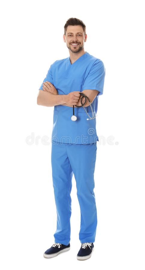 Full length portrait of smiling male doctor in scrubs. Medical staff. Full length portrait of smiling male doctor in scrubs isolated on white. Medical staff royalty free stock images