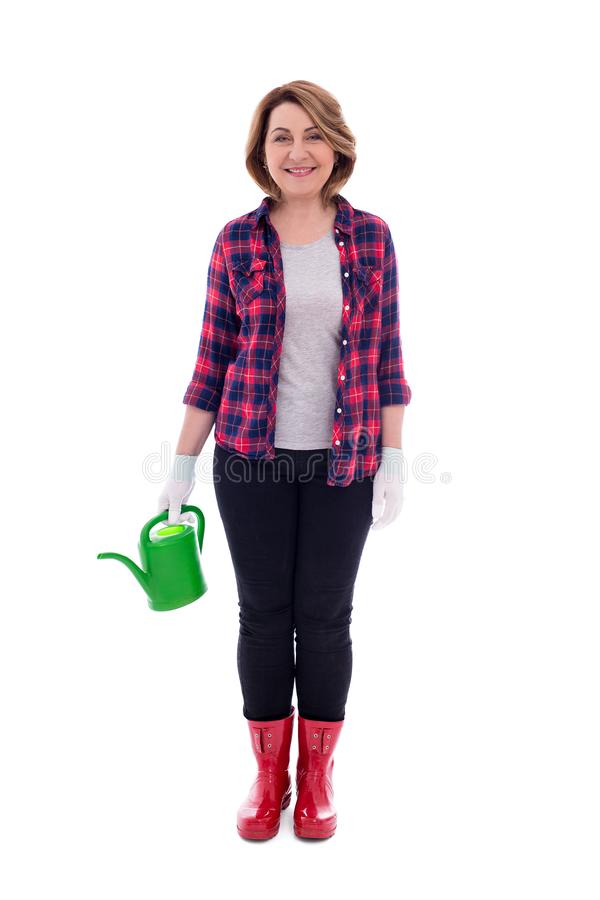 Full length portrait of middle aged woman gardener with watering can isolated on white background royalty free stock photography