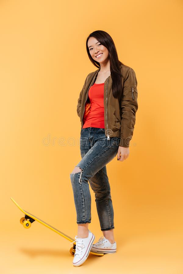 Full length portrait of a smiling pretty girl stock photography