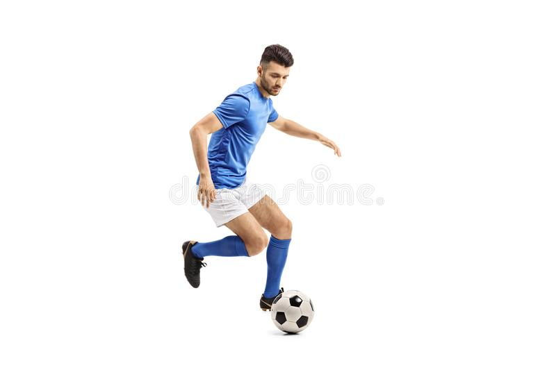 Soccer player dribbling royalty free stock photography