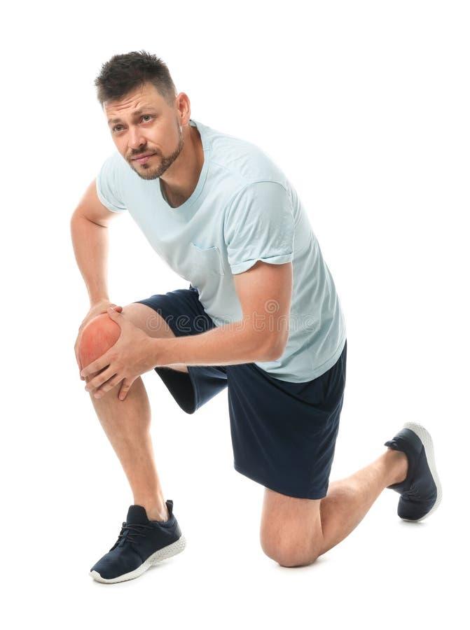Full length portrait of sportsman having knee problems on white royalty free stock photo