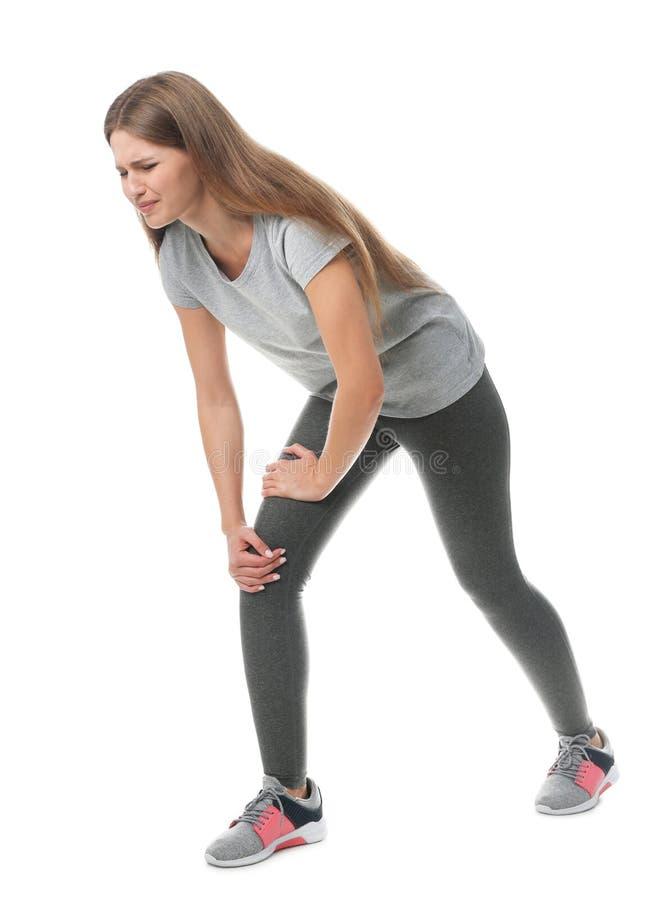 Full length portrait of sportswoman having knee problems. On white background stock image